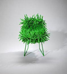 Green chair, designer unknown.  'Campana Bros. Brazilian vibe to it.