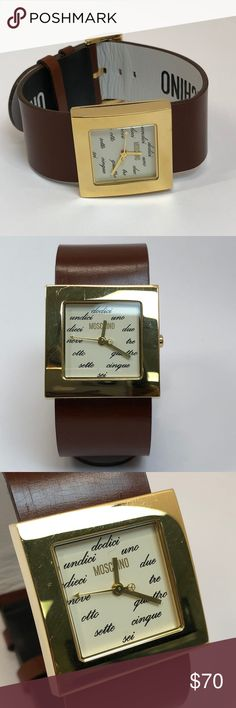 """Moschino Gold Square Face Brown Band Watch Moschino gold square face """"Time 4 Peace"""" watch. Tan brown wrist band with black and white color on bottom. Cursive lettering. Watch face is easily removable for customization.  Length: 9.25""""  Width: 1""""  Condition: Excellent pre-owned condition. Normal signs of light wear. Moschino Accessories Watches"""