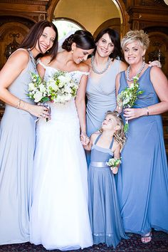 Full length classic bridesmaid dresses, in different shades of blue