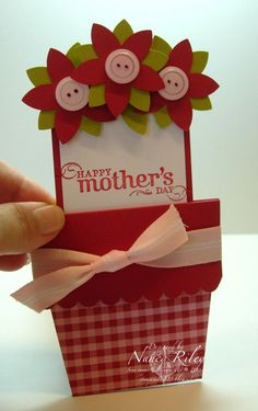 So sweet! The pot is like an envelope, and the flowers are the card (like a tag) that pulls out.