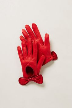 Let's all join gloved hands and bring back the these glamorous accessories! red leather driving gloves with bows.