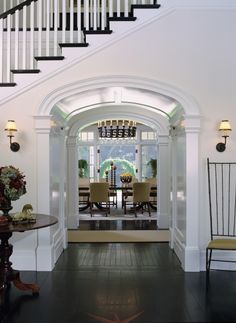 Archway Hall under Stairs toward Dining Room (Dutch Colonial in California by Tommy Chambers Interiors). Dark wood stairs with light walls and white trim. House Design, New Homes, Beautiful Homes, Under Stairs, House, Home, Interior, Dutch Colonial, Home Decor