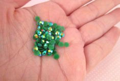 These 4mm AB jelly flat backed resin rhinestones are awesome for all your crafting projects such as jewelry, cell phone deco, nails etc... I have these in a ton of colors and sizes!  Size: approx. 4mm Color: Dark Green Quantity: Pick the amount you would like in the drop down menu Material: Resin