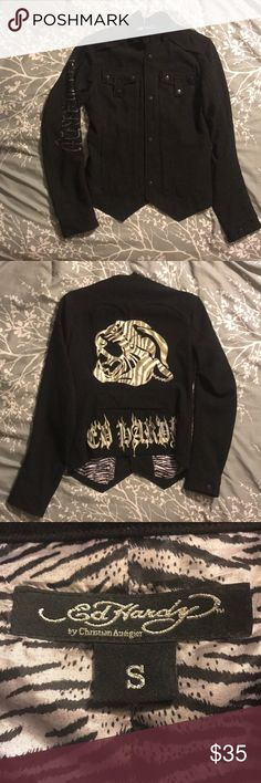SALE‼️ Ed Hardy Blazer 🐯 Black Blazer, Ed Hardy By Christian Audigier. Black and diamond rhinestones spell out Ed Hardy along the right sleeve, a few black rhinestones are missing but is not noticeable. Has two pockets above the left and right breast and two easy accessible side pockets. The Blazer is comfortable and breathable. 🐯🦓  Thanks for shopping my closet! 🌻💋 Ed Hardy Jackets & Coats Blazers