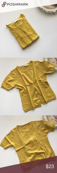 ZARA cardigan Pretty short sleeves cardigan from Zara trf In great condition except a small pull thread, see last photo Ribbed small cuff sleeves and hem  Color is mustard yellow, close to as it appears in photos Size M Zara Sweaters Cardigans