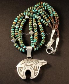 This elegant Necklace features a Sterling Silver Bear Pendant by Navajo artist Richard Singer. The Pendant is beautifully crafted, displaying traditional Navajo designs that have been oxidized for gre Navajo Jewelry, Southwest Jewelry, Tribal Jewelry, Turquoise Jewelry, Kingman Turquoise, Silver Jewelry, Jewelry Necklaces, Jewellery, Bohemian Jewelry