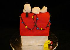 This is a chocolate sponge cake with vanilla buttercream icing, vanilla simple syrup, and Michele Foster's fondant. Snoopy, Woodstock, the Christmas wreath, and as well as the light bulbs are all fondant. The strings for the lights are royal icing. I used Debbie Brown's cake as inspiration. Merry Christmas!