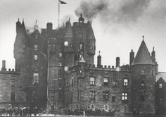 Smoke billows from Glamis Castle during the fire in September 1916. Glamis Castle is the family home of Elizabeth Bowes-Lyon, future wife of George VI