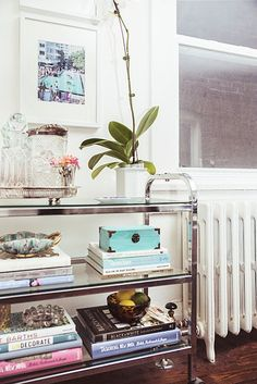 Turn one into a bookshelf with coffee table books and objets d'art. | 25 Awesomely Creative Ways To Use A Bar Cart