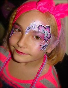 Really cute one stroke flower face paint design.