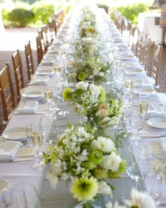 "Dinner was served under a tent. Guests were divided among three long tables set with crisp white linens and custom runners. ""We decided to mix our friends so they could all meet and spend time together,"" Megan says. ""It was a risk that paid off."""