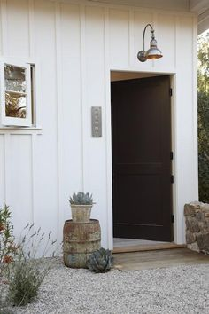 gravel up to a side door, board/batten walls, succulents, barn lighting, window style Love this!!