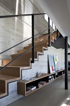Concrete, Black Steel, And Wood Stairs
