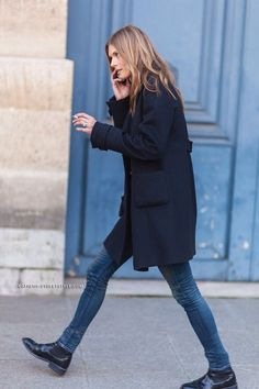 She looks lovely wearing nice black boots with jeans and would be interesting to see what colour of socks she is wearing with them.