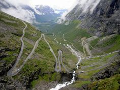 """Trollstigen, Norway: The serpentine """"Troll's Way"""" winds through 11 hairpin turns at grades of up to 9% on its way up to a 2,790-foot mountain pass. Try not to be distracted by the 1,050-foot Stigfossen waterfall that tumbles down alongside the route and into the valley far below."""
