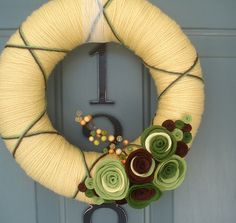 More yarn wreaths -- love the colors