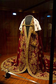 The mantle of the Austrian Empire  Design: Philipp von Stubenrauch (1784-1848) Execution: Johann Fritz, Master Gold Embroiderer Vienna, 1830 Red and white velvet, gold embroidery, sequins, ermine, whit silk 276 cm long