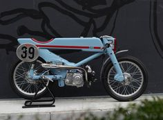 deus ex machina begins with a 1961 honda super cub, strips it back to the essentials, and gives it this striking silhouette with a custom frame and composite body.\n