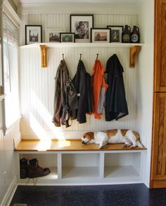 someday I will have any entry way. I love the look of this painted bead board and the shoe cubby beneath the bench.