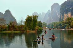 Bamboo rafting on the Yulong River, Yangshuo,Guangxi   China