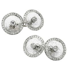Cartier Rock Crystal Diamond Platinum Cufflinks. Cartier, A Pair of Early 20th Century Rock Crystal and Diamond Cufflinks, each designed as a pair of carved rock crystal disks, within circular-cut diamond frames, mounted in platinum, signed Cartier, circa 1900.