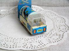 https://www.etsy.com/listing/500368846/soviet-vintage-tin-toy-train-1970s?ref=shop_home_active_1