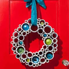 The classic holiday wreath gets a modern update in PVC pipe, an inexpensive material readily found at the home center, though ours was made from leftovers cut down with a miter saw. Ornaments placed inside pipe recesses lend a dose of color. Add an oversize bow and you've got a sculptural statement piece for the front door.