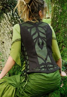 This beautiful woolen Psyche waistcoat with faux suede, cutwork detail took its inspiration from the growth and radiance of veins in leaves and the branches of trees. it has many beautiful details of side lacing, handmade brass fastening and cutwork, front and back.