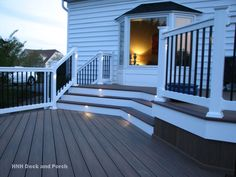 Vinyl deck with i-lighting accent lights and wolf PVC decking in amberwood.