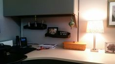 Shelves provide space to display things in cubicle