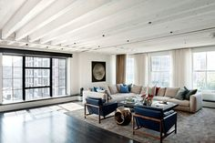 Laight Street Loft - industrial - living room - new york - David Howell Design I loves these blue leather chairs