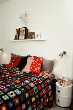 I need to finish my granny square afghan that I started before I was married.  Then I could have a bed like this one.