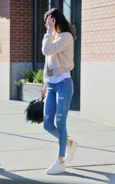 Kendall Jenner wearing Designers Remix Saturday Jack Short Shearling Jacket, Celine Sneaker Pull on in Optic White Stretched Lambskin, Givenchy Micro Nightingale Shoulder Bag in Black Goat Hair and Leather and RTA Sonia Pull-on Jeans in Blue Mist