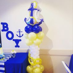 Anchor balloon columns. Yellow, royal blue and white nautical theme