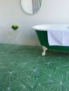 These clustered hexagon tiles from Claesson Koivisto Rune create a leafy effect when used in mass on a bathroom floor.