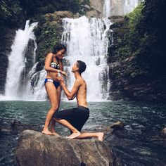 Loving this romantic waterfall marriage proposal! She didn't notice he was on one knee at first, and then he proposed. <3