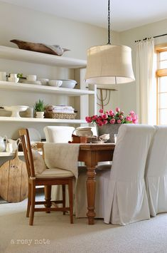 LOVE THE HANGING LIGHT AND THOSE COVERED CHAIRS