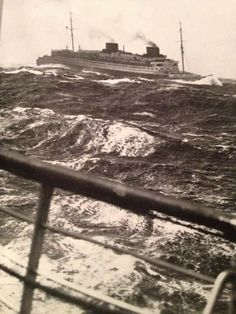 SS EUROPA in heavy seas photographed from the deck of SS BREMEN.