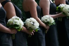 Adore this classic look: black bridesmaid dresses and white bouquets.