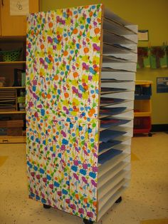 Drying rack for art work made from pizza boxes.