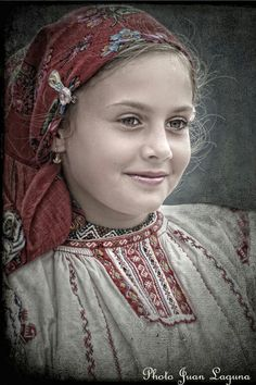 """Gypsy This isn't a gypsy, this a young Hungarian girl in traditional dress. """"Gypsies"""" in Hungary are darker skinned, darker eyed and of an entirely different facial structure (see Anthropology of Middle Europe)."""