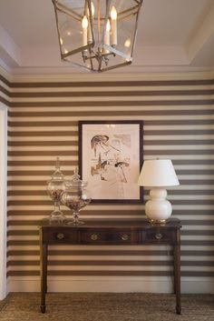 Simple entryway console with dramatic striped backdrop.