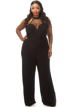 This hot plus size jumpsuit features a sweetheart mesh top, peekaboo back and wide leg bottom. Soft, stretch material Tight fit 96% Polyester 4% Spandex Model wearing 3X Made in USA