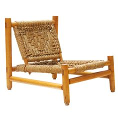 Charlotte Perriand style low profile sisal rope woven chairs.