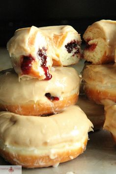 Peanut Butter and Jelly Donuts - They were just so pillowy light and fluffy, with layers of crackly vanilla glaze, oozing raspberry jam and creamy peanut butter glaze that should really be classified as more of a glossy frosting.