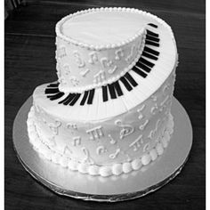 Piano cake!!! I have decided that this WILL be my wedding cake! Add a few more layers, have the background a Malibu blue, all of the music notes and symbols will be yellow, and then the keyboard swirling up to the top! :) The only thing that could make it better would be a mini-grand piano topper with the bride and groom playing the piano. :)