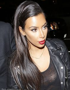 Remarkably smooth: Kim's face and forehead were free of almost any sign of lines or wrinkl...