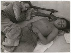 Two young boys sleeping next to their guns, Cordoba front, Spain//Robert Capa, 1936