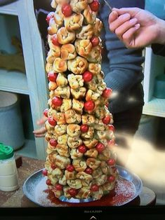 Garlic bread knot Christmas tree. Styrofoam tree covered in collards. Garlic knots and cherry tomatoes tooth picked on. Marinara tree skirt with Parmesan snow! Great for holiday party