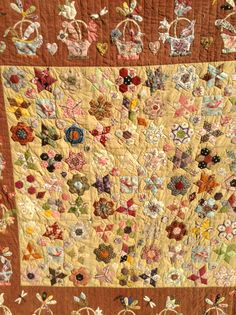 Close up of my Basket and Hexie quilt,English paper pieced,appliquéd and hand quilted by Lisa Egan.....I made this in a class with Karen Cunningham,this is her adaptation of a 19th century Folk Art quilt,sadly maker unknown.